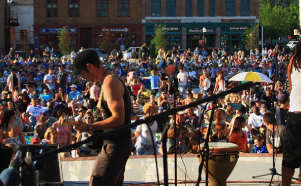 A band performing on stage at the 400 block during concert on the square in Wausau