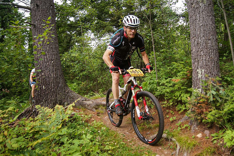 Mountain bike rider riding a single track trail through the woods